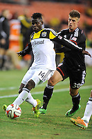 Washington D.C. - March 8, 2014: Waylon Francis (14) of the Columbus Crew goes against Conor Doyle (30) of D.C. United. The Columbus Crew defeated D.C. United 3-0 during the opening game of the 2014 season at RFK Stadium.