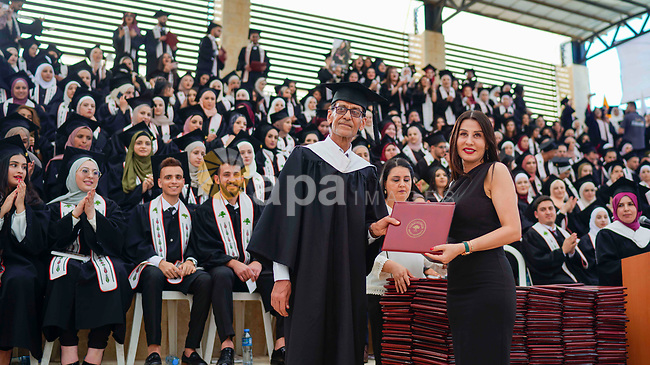 Palestinian students attend their graduation ceremony at Birzeit University in the West Bank city of Ramallah, on June 30, 2021. Photo by Eyad Jadallah
