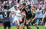 Dele Alli of England challenges David Edwards of Wales at the Stade Bollaert-Delelis in Lens, France this afternoon during their Euro 2016 Group B fixture.