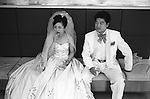The Peoples Republic of China. Shanghai. The Venus Plaza Wedding Studio.  The fashion for Western white weddings became popular among affluent middle class Chinese in the 1930s, and reappeared in the late 1980s. You will find the bride is still wearing traditional red shoes for good luck.