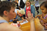 Triple Deck-Her signs an autograph after a roller derby bout in Wilmington, Massachusetts. Roller derby is an American contact sport, popular with young women, which combines both athleticism and a satirical punk third-wave feminism aesthetic.