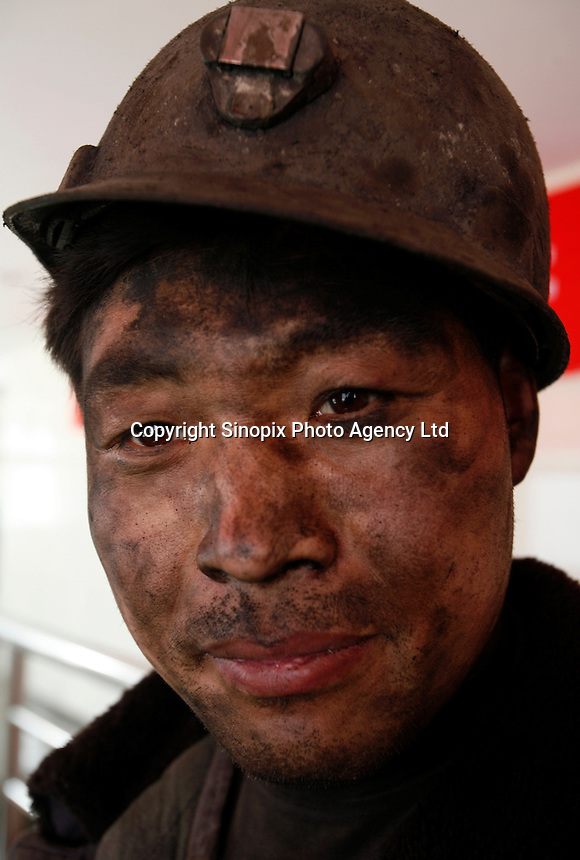 A coal miner on the surface after a 12 hour shift at one of the state-owned mines near Luoyang, Henan Province, China..