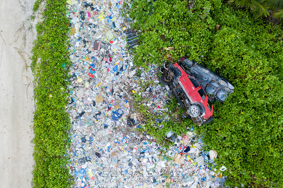 An aerial view of a dumpsite at the northern end of Fongafale island. Waste management is a problem for an island nation such as Tuvalu that's located in a remote corner of the pacific Ocean. At the moment, solid waste is collected in this one location however it lies just metres away from the central lagoon and ocean threatening the local ecosystem. Funafuti, Tuvalu. March, 2019.