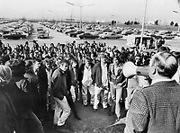 Air Canada service workers; who staged a wildcat strike yesterday that disrupted flights by the airline out of Toronto International Airport; are addressed by Dough Walker; business representative of Local 2323 of Machinists and Aerospace Workers union. They were protesting slow pace of contract negotiations.<br /> Griffin, Doug<br /> Picture, 1973