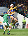 Richie McCarthy of Limerick in action against Aron Shanagher of Clare during their Munster Championship semi-final at Thurles.  Photograph by John Kelly.