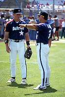 Houston Astros Jeff Bagwell listens to coach Phil Garner (3) during spring training circa 1991 at Chain of Lakes Park in Winter Haven, Florida.  (MJA/Four Seam Images)