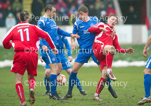 Brechin v St Johnstone....12.03.11  Scottish Cup Quarter Final.Rory McAllister battles with Jamie Adams and Dave Mackay.Picture by Graeme Hart..Copyright Perthshire Picture Agency.Tel: 01738 623350  Mobile: 07990 594431
