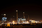 The under construction Adani Power plant of 4620 MW capacity in Mundra port industrial city of Gujarat, India. Indian power companies have handed out dozens of major contracts to Chinese firms since 2008. Adani Power Ltd have built elaborate Chinatowns to accommodate Chinese workers, complete with Chinese chefs, ping pong tables and Chinese television. Chinese companies now supply equipment for about 25% of the 80,000 megawatts in new capacity.