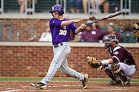 LSU Tigers shortstop Alex Bregman (30) follows through on his swing against the Texas A&M Aggies in the NCAA Southeastern Conference baseball game on May 10, 2013 at Blue Bell Park in College Station, Texas. LSU defeated Texas A&M 7-4. (Andrew Woolley/Four Seam Images).