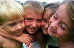 2 boys and 2 girls (all 4-6 years old) squishing their faces together for the camera