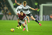 Tim Ream of Fulham tackles Javier Hernandez of West Ham United during West Ham United vs Fulham, Premier League Football at The London Stadium on 22nd February 2019