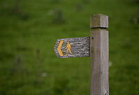 A country path sign in the village of Staylittle (Penffordd-Las in welsh)