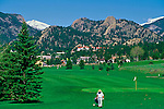 One of Estes Park's summer recreations, golfing, can be seen on a regular basis.  Castle Mtn., Deer Mtn., and the historic Stanley Hotel are part of the scenery for the 9-hole course, one of two golf courses in Estes Park.