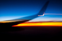 Abstract image of airplane wing at sunset