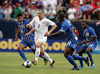Heath Pearce (2) dribbles through Honduran players Melvin Valladares (18, left), and Osman Chavez (2, second from right).  The US Men's National Team defeated Honduras 2-0 in the semifinals of the Gold Cup at Soldier Field in Chicago, IL on July 23, 2009.