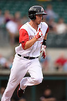 Arkansas Travelers designated hitter Alex Yarbrough (7) runs to first during a game against the San Antonio Missions on May 24, 2014 at Dickey-Stephens Park in Little Rock, Arkansas.  Arkansas defeated San Antonio 4-2.  (Mike Janes/Four Seam Images)