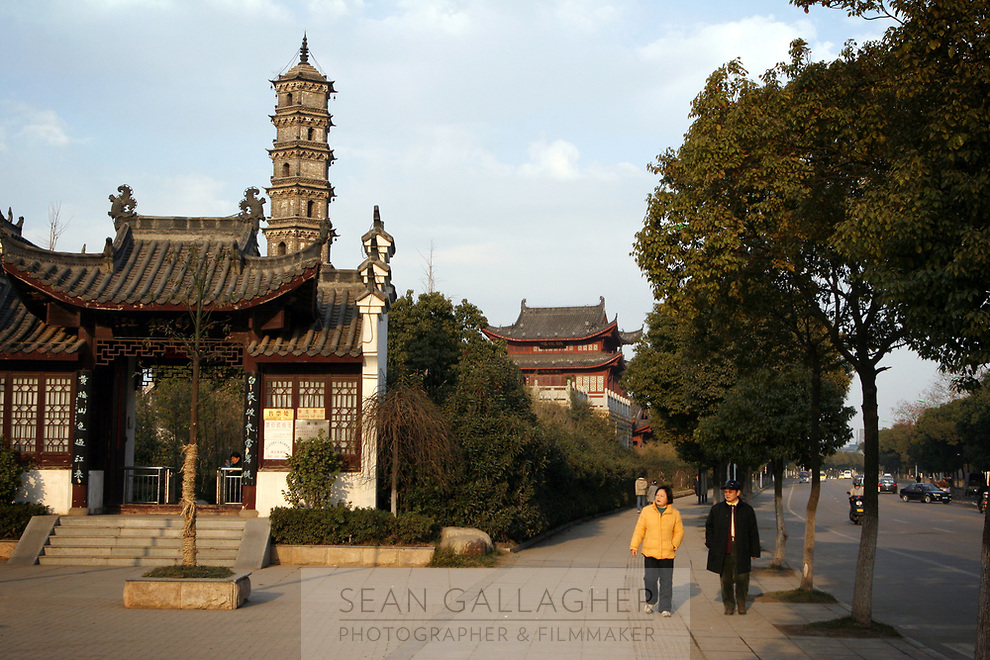 CHINA. Jiangxi Province. Jiujiang. Pedestrians walk past a traditional tower on the banks of the Yangtze River.. Jiujiang is a city of 4.6 million people, located on the southern shore of the Yangtze River. The Yangtze River is reported to be at its lowest level in 150 years as a result of a country-wide drought. It is China's longest river and the third longest in the world. Originating in Tibet, the river flows for 3,964 miles (6,380km) through central China into the East China Sea at Shanghai.  2008