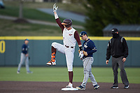 TJ Rumfield (7) of the Virginia Tech Hokies signals to his dugout as he stands on second base during the game against the Georgia Tech Yellow Jackets at English Field on April 16, 2021 in Blacksburg, Virginia. (Brian Westerholt/Four Seam Images)