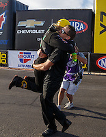 Feb 28, 2016; Chandler, AZ, USA; NHRA top fuel driver Leah Pritchett celebrates with husband Gary Pritchett after winning the Carquest Nationals at Wild Horse Pass Motorsports Park. Mandatory Credit: Mark J. Rebilas-