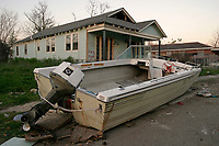 New Orleans, LA--A boat sits on the sidewalk, guarding row after row of abandoned houses in the hard-hit 9th Ward.Liam Maloney / Special to The Gazette