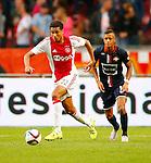 Nederland, Amsterdam, 15 augustus 2015<br /> Eredivisie<br /> Seizoen 2015-2016<br /> Ajax-Willem ll (3-0)<br /> Jairo Riedewald van Ajax in actie met bal. Rechts Richairo Zivkovic van Willem II