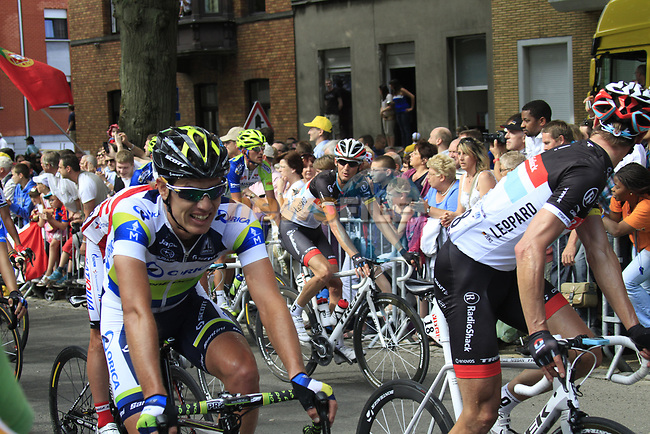 The peloton crosses the finish line at the end of Stage 2 of the 99th edition of the Tour de France 2012, running 207.5km from Vise to Tournai, Belgium. 2nd July 2012.<br /> (Photo by Eoin Clarke/NEWSFILE)