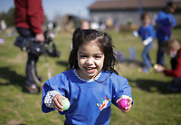 Isabella Owen, 2, of Centerton holds Easter eggs she collected, Friday, April 2, 2021 at 10107 Andy Buck Road in Pea Ridge. No Limit Pediatric Therapies held its first special needs friendly Easter egg hunt in celebration of World Autism Awareness Day. Check out nwaonline.com/210403Daily/ for today's photo gallery. <br /> (NWA Democrat-Gazette/Charlie Kaijo)