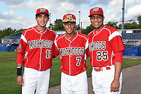 Batavia Muckdogs Hiram Martinez (15), Iramis Olivencia (7) and Carlos Duran (25) pose for a photo before a game against the Auburn Doubledays on June 14, 2014 at Dwyer Stadium in Batavia, New York.  Batavia defeated Auburn 7-2.  (Mike Janes/Four Seam Images)