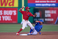 Clearwater Threshers shortstop Luis García (5) attempts to turn a double play as Jose Rivas slides in during a game against the Dunedin Blue Jays on May 20, 2021 at BayCare Ballpark in Clearwater, Florida.  (Mike Janes/Four Seam Images)