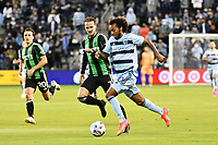KANSAS CITY, KS - MAY 9: Gianluca Busio #10 Sporting KC with the ball during a game between Austin FC and Sporting Kansas City at Children's Mercy Park on May 9, 2021 in Kansas City, Kansas.