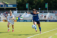 CARY, NC - SEPTEMBER 12: Christen Westphal #18 of the Portland Thorns gives chase as Debinha #10 of the NC Courage keeps the ball in play during a game between Portland Thorns FC and North Carolina Courage at Sahlen's Stadium at WakeMed Soccer Park on September 12, 2021 in Cary, North Carolina.
