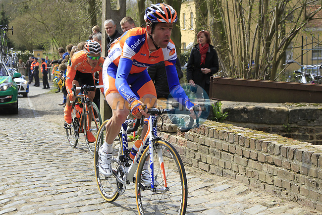 The peloton including Bram Tankink (NED) Rabobank climbs Molenberg during the 96th edition of The Tour of Flanders 2012, running 256.9km from Bruges to Oudenaarde, Belgium. 1st April 2012. <br /> (Photo by Eoin Clarke/NEWSFILE).