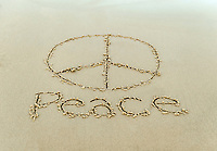 Peace sign drawn in the beach sand.