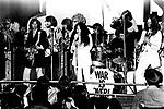 John Lennon 1969 War Is Over concert at the Lyceum in London with Eric Clapton, Delaney Bramlett, George Harrison, Bonnie Bramlett Bramlett, Jim Gordon and John Lennon, December 15th 1969.<br /> <br /> Lennon, Harrison, Clapton and Delaney Bramlett (guitars, with Clapton playing Rocky, Harrison's psychedelic Fender Stratocaster); Ono (vocals); Bonnie Bramlett (tambourine); Alan White and Jim Gordon (drums); Billy Preston (organ); Klaus Voormann (bass guitar); Bobby Keys (saxophone); Jim Price (trumpet). Lennon later referred to it as the Plastic Ono Supergroup.
