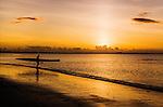 Going for a paddle at sunset on Nadi Bay off Wailoaloa Beach, Viti Levu, Fiji Islands