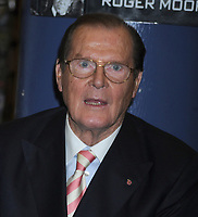NEW YORK, NY - NOVEMBER 09:  Sir Roger Moore meets fans and signs copies of his book 'Bond on Bond' on November 9, 2012 in New York City.<br /> <br /> <br /> People:  Sir Roger Moore