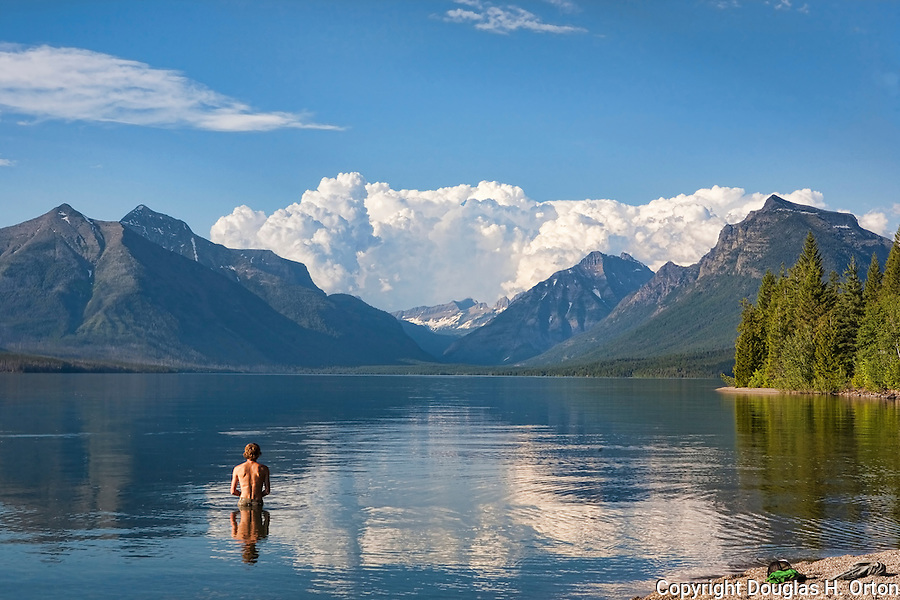Lake McDonald, gem of Glacier National Park in the U.S. State of Montana, at ten miles long and over a mile wide is the largest lake in the park.  On a hot summer day, even the glacial water feels good!