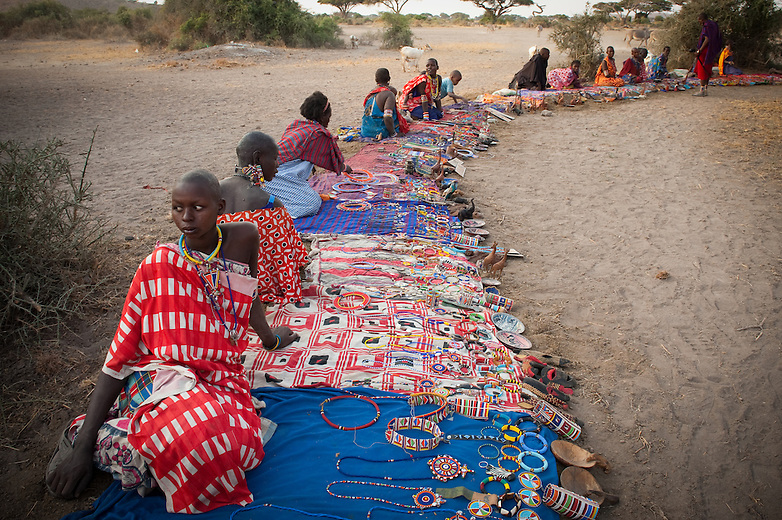 Maasai women earn a few shillings by selling beadwork and small curios to visiting tourists. The women buy the plastic beads in  shopping centers that may be up to 50 miles away.  Beadwork is an important means of social interaction and a creative outlet from their daily tasks of looking after the children, milking the cows, cooking, and constructing homes and animal pens.