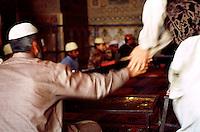Young boys at the Koran school in the Wazir Khan Mosque in Lahore.<br /> 18.2.2001, Lahore/Pakistan<br /> Copyright: Christian-Ditsch.de<br /> [Inhaltsveraendernde Manipulation des Fotos nur nach ausdruecklicher Genehmigung des Fotografen. Vereinbarungen ueber Abtretung von Persoenlichkeitsrechten/Model Release der abgebildeten Person/Personen liegen nicht vor. NO MODEL RELEASE! Nur fuer Redaktionelle Zwecke. Don't publish without copyright Christian-Ditsch.de, Veroeffentlichung nur mit Fotografennennung, sowie gegen Honorar, MwSt. und Beleg. Konto: I N G - D i B a, IBAN DE58500105175400192269, BIC INGDDEFFXXX, Kontakt: post@christian-ditsch.de<br /> Bei der Bearbeitung der Dateiinformationen darf die Urheberkennzeichnung in den EXIF- und  IPTC-Daten nicht entfernt werden, diese sind in digitalen Medien nach §95c UrhG rechtlich geschuetzt. Der Urhebervermerk wird gemaess §13 UrhG verlangt.]