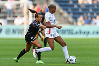 BRIDGEVIEW, IL - JULY 18: Tziarra King #23 of the OL Reign dribbles the ball during a game between OL Reign and Chicago Red Stars at SeatGeek Stadium on July 18, 2021 in Bridgeview, Illinois.