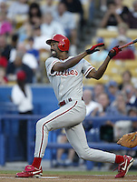 Doug Glanville of the Philadelphia Phillies bats during a 2002 MLB season game against the Los Angeles Dodgers at Dodger Stadium, in Los Angeles, California. (Larry Goren/Four Seam Images)