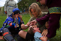 """Rowan, a five-year-old autistic child, cries while visiting a shaman with his parents during a horseback expedition across Mongolia. Rowan, who has been nicknamed """"The Horse Boy"""", embarked on a therapeutic journey of discovery with his parents to visit a succession of shaman healers in one of the most remote regions in the world. Following Rowan's positive response to a neighbour's horse, Betsy, and some reaction to treatment by healers, Rowan's parents hoped that the Mongolian shamanistic rituals along the route and the prolonged contact with horses would help to unlock their son's autism and assist his development.."""