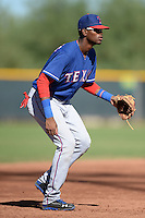 Texas Rangers third baseman Ti'Quan Forbes (77) during an Instructional League game against the Cincinnati Reds on October 3, 2014 at Surprise Stadium Training Complex in Surprise, Arizona.  (Mike Janes/Four Seam Images)