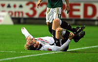 ATTENTION SPORTS PICTURE DESK<br /> Pictured: Injured Gorka Pintado on the ground<br /> Re: Coca Cola Championship, Swansea City Football Club v Plymouth Argyle at the Liberty Stadium, Swansea, south Wales. Tuesday 08 December 2009