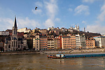 A barge passes along the Saone river, Lyon, France, 14 January 2012. The Saint-Georges church is on the left.