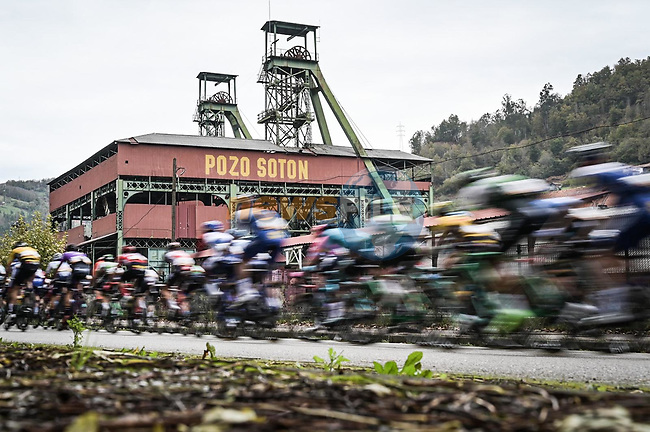 The peloton pass by one of the many coal mines during Stage 12 of the Vuelta Espana 2020 running 109.4km from Pola de Laviana to Alto de l'Angliru, Spain. 1st November 2020. <br /> Picture: Unipublic/Charly Lopez | Cyclefile<br /> <br /> All photos usage must carry mandatory copyright credit (© Cyclefile | Unipublic/Charly Lopez)