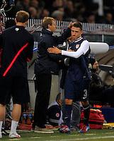 GENOVA, ITALY - February 29, 2012: Coach Juergen Klinsmann (l, USA) changes Fabian Johnson (r, USA) during the USA friendly match against Italy at the Stadium Luigi Ferraris in Genova, Italy.