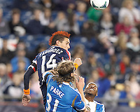 New England Revolution midfielder Diego Fagundez (14) heads the ball. In a Major League Soccer (MLS) match, the New England Revolution (blue/red) defeated Philadelphia Union (blue/white), 2-0, at Gillette Stadium on April 27, 2013.
