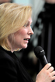Washington, D.C. - January 4, 2010 -- United States Senator Kirsten Gillibrand (Democrat of New York) questions U.S. President Barack Obama about the delay in judicial appointments during a question and answer session of the Senate Democratic Policy Committee Issues Conference at the Newseum in Washington, D.C. on Wednesday, February 3, 2010..Credit: Ron Sachs / Pool via CNP