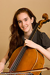 Middle School grade 8 music education portrait of girl holding her cello vertical